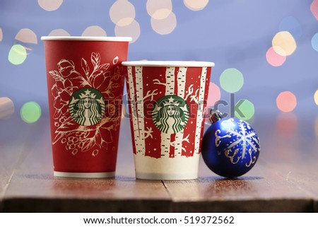 Kuala Lumpur -Malaysia,November 18, 2016: The new paper cup of Starbucks stores in the country for the Christmas on a red background cup. Starbucks brand is one of the world famous from US