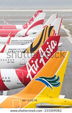 KUALA LUMPUR, MALAYSIA - OCTOBER 19, 2014 : A fleet of  budget airliners at the newly built airport of KLIA2. - stock photo