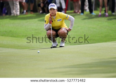 KUALA LUMPUR, MALAYSIA - OCTOBER 29, 2016:Amy Yang of South Korea prepares her putt at the green of the TPC Golf Course at the 2016 Sime Darby LPGA Malaysia golf tournament.