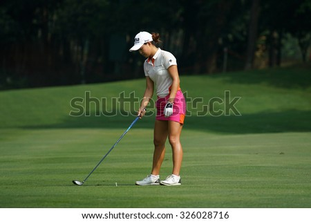 KUALA LUMPUR, MALAYSIA - OCTOBER 09, 2015: Australia's Minjee Lee prepares to hit from 6th hole fairway at the KL and Golf & Country Club at the 2015 Sime Darby LPGA Malaysia golf tournament. - stock photo