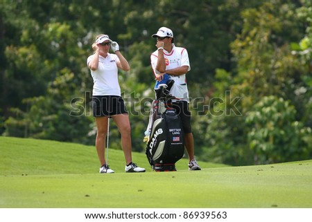 KUALA LUMPUR, MALAYSIA - OCTOBER 16: Brittany Lang of the USA discusses with her caddie on the fairway at the Sime Darby LPGA  Malaysia 2011 golf tournament on Oct 16, 2011 in Kuala Lumpur, Malaysia. - stock photo