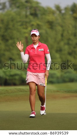 KUALA LUMPUR, MALAYSIA - OCTOBER 16: Chella Choi of South Korea waves to the cheering crowd on day 4 of the Sime Darby LPGA Malaysia 2011 golf tournament on Oct 16, 2011 in Kuala Lumpur, Malaysia. - stock photo