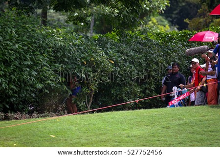 KUALA LUMPUR, MALAYSIA - OCTOBER 29, 2016: Ha Na Jang plays from inside the bushes at the fairway of the TPC Golf Course at the 2016 Sime Darby LPGA Malaysia golf tournament.