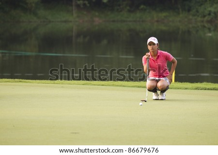 KUALA LUMPUR, MALAYSIA - OCTOBER 15: Japanese Ai Miyazato takes aim on the green on Day 3 of Sime Darby LPGA Golf October 15, 2011 in Kuala Lumpur, Malaysia.