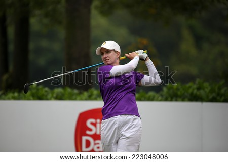 KUALA LUMPUR, MALAYSIA - OCTOBER 11, 2014: Karie Webb of Australia tees off at the fourth hole of the KL Golf & Country Club during the 2014 Sime Darby LPGA Malaysia got tournament. - stock photo