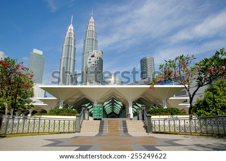 KUALA LUMPUR, MALAYSIA - OCTOBER 9 : Masjid Asy-Syakirin Muslim Mosque in Kuala Lumpur City Center Park Malaysia with Petronas Towers at the background, Kuala Lumpur, Malaysia - stock photo