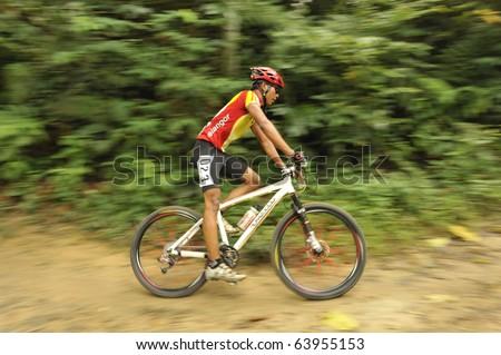 KUALA LUMPUR, MALAYSIA - OCTOBER 24:  Men's 31-35 Heat in KL Mountain Bike Carnival at Taman Lembah Kiara, TTDI October 24, 2010 in Kuala Lumpur, Malaysia. - stock photo