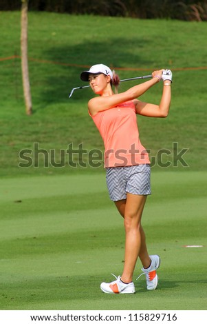 KUALA LUMPUR, MALAYSIA - OCTOBER 10: Michelle Wie of USA watches her shot to hole #9 on day 2 of the Sime Darby LPGA Malaysia 2012 golf tournament on Oct 10, 2012 in Kuala Lumpur, Malaysia. - stock photo