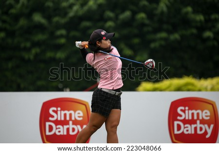 KUALA LUMPUR, MALAYSIA - OCTOBER 11, 2014: Moriya Jutanugarn of Thailand tees off at the second hole of the KL Golf & Country Club during the 2014 Sime Darby LPGA Malaysia got tournament. - stock photo