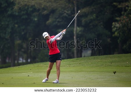 KUALA LUMPUR, MALAYSIA - OCTOBER 10, 2014: So Yeon Ryu Ji of South Korea plays on the fairway of the ninth hole of the KL Golf & Country Club at the 2014 Sime Darby LPGA Malaysia golf tournament. - stock photo