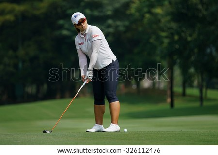 KUALA LUMPUR, MALAYSIA - OCTOBER 09, 2015: South Korea's Amy Yang prepares to hit from the 6th hole fairway at the KL Golf & Country Club at the 2015 Sime Darby LPGA Malaysia golf tournament. - stock photo