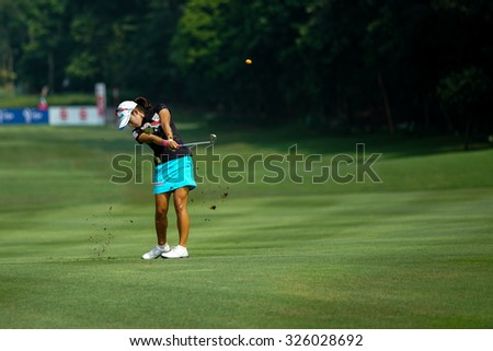 KUALA LUMPUR, MALAYSIA - OCTOBER 09, 2015: South Korea's Mi Hyang Lee plays from 6th hole fairway of the Kuala Lumpur Golf & Country Club at the 2015 Sime Darby LPGA Malaysia golf tournament. - stock photo