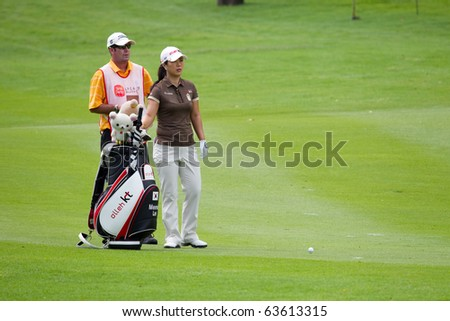 KUALA LUMPUR, MALAYSIA - OCTOBER 24: South Korean Meena Lee evaluates next shot with her caddy on Day 3 of the Sime Darby LPGA Golf on October 24, 2010 in Kuala Lumpur, Malaysia. Lee finished 5th