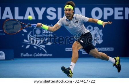 KUALA LUMPUR, MALAYSIA - OCTOBER 03, 2015: Spain's tennis player David Ferrer plays a forehand return at the 2015 Malaysian Open tennis tournament from Sep 26 - Oct 4, 2015 in Stadium Putra. - stock photo