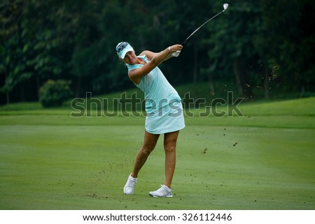 KUALA LUMPUR, MALAYSIA - OCTOBER 09, 2015: Sweden's Anna Nordqvist hits from the 6th hole fairway at the KL Golf & Country Club at the 2015 Sime Darby LPGA Malaysia golf tournament. - stock photo