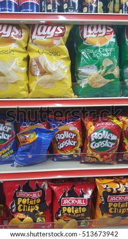 Kuala Lumpur, Malaysia - October 8th, 2016 : Fast food snacks for sale on supermarket shelf.