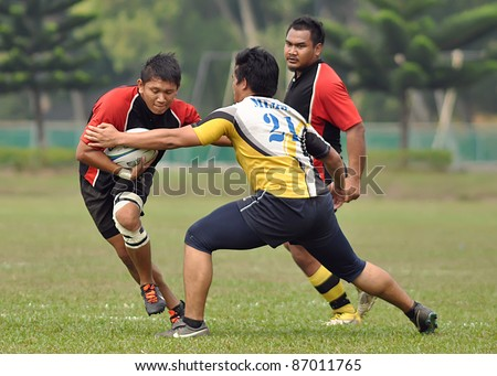 KUALA LUMPUR, MALAYSIA - OCTOBER 15: Unidentified participants in action during a 10s Rugby Vice-Chancellor Cup at National Defense University Of Malaysia, Kuala Lumpur, Malaysia on October 15, 2011. - stock photo