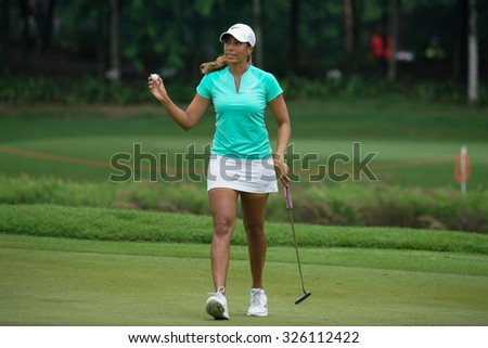 KUALA LUMPUR, MALAYSIA - OCTOBER 09, 2015: USA's Cheyenne Woods reacts after putting the 18th hole green at the KL Golf & Country Club at the 2015 Sime Darby LPGA Malaysia golf tournament. - stock photo