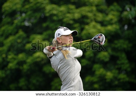 KUALA LUMPUR, MALAYSIA - OCTOBER 10, 2015: USA's Jessica Korda tees off at the sixth hole of the KL Golf & Country Club on Round 3 day at the 2015 Sime Darby LPGA Malaysia golf tournament. - stock photo