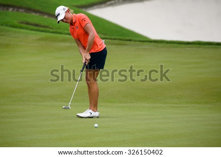 KUALA LUMPUR, MALAYSIA - OCTOBER 10, 2015: USA's Stacy Lewis putts on the green of the 18th hole of the KL Golf & Country Club during the 2015 Sime Darby LPGA Malaysia golf tournament.  - stock photo