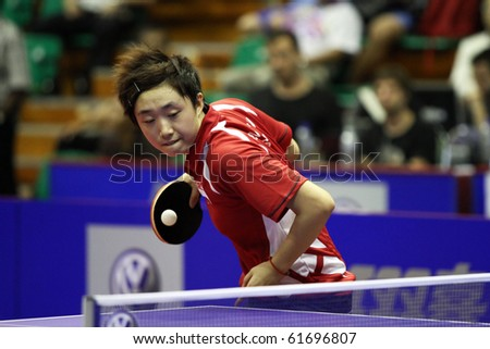 KUALA LUMPUR, MALAYSIA - SEPTEMBER 24: Feng Tianwei of Singapore (ITTF World Rank 2) serves in her match at the Volkswagen 2010 Women's World Cup in table tennis on September 24, 2010 in Kuala Lumpur. - stock photo