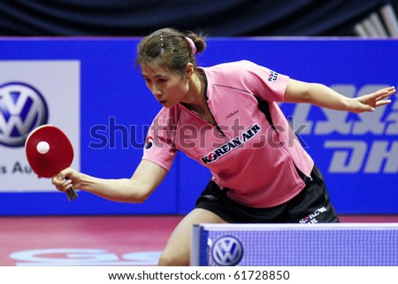 KUALA LUMPUR, MALAYSIA - SEPTEMBER 24: Kim Kyung Ah, South Korea (ITTF World Rank 10) hits a return shot at the Volkswagen 2010 Women's World Cup in table tennis on September 24, 2010 in Kuala Lumpur. - stock photo
