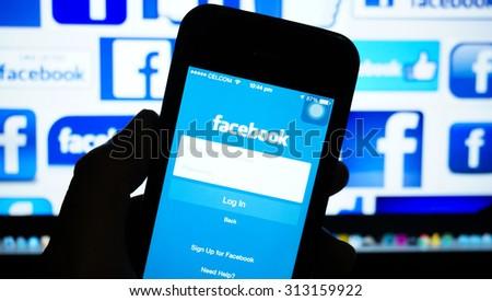 KUALA LUMPUR, MALAYSIA - SEPTEMBER 04, 2015: Photo of Facebook homepage on a Iphone monitor screen. - stock photo
