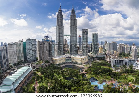 KUALA LUMPUR, MALAYSIA - SEPTEMBER 28: View of The Petronas Twin Towers on September 28, 2010 in Kuala Lumpur. The skyscraper (451.9m/88 floors) is the tallest twin buildings in the world - stock photo