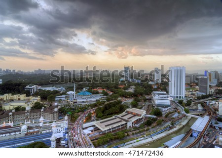 KUALA LUMPUR , MALAYSIA -26/02/2016; Sunset in the city view in HDR.Image has grain or blurry or noise and soft focus when view at full resolution. (Shallow DOF ).