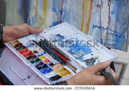 KUALA LUMPUR, MALAYSIA - 12TH APRIL 2015; Close up of artist's work at colonial style buildings or pre-war shop in Lebuh Pasar, at downtown street, in Kuala Lumpur, Malaysia.