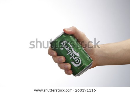 Kuala Lumpur,Malaysia 9th April 2015,hand holding a can of the carlsberg beer drink - stock photo