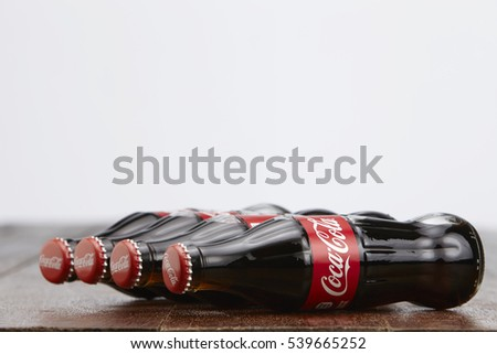 Kuala Lumpur, Malaysia 12th December 2016,coca cola soft drink on wooden table top