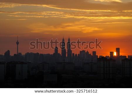 KUALA LUMPUR, MALAYSIA - 28TH JUNE 2013; Majestic sunset over Kuala Lumpur skyline. - stock photo