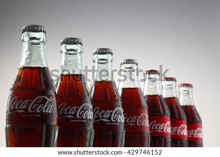 Kuala Lumpur, Malaysia 30th May 2016, Coca-Cola Classic in a glass bottle Isolated on white Background. Coca Cola, Coke is the most popular carbonated soft drink beverages sold around the world - stock photo