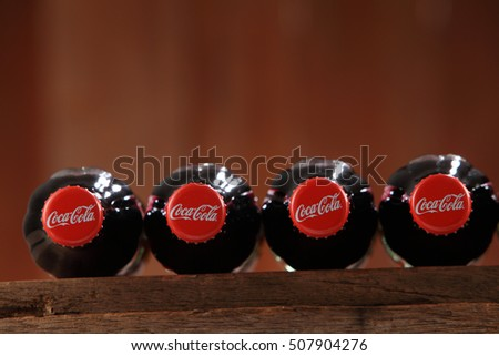 Kuala Lumpur, Malaysia 26th Oct 2016,coca cola glass bottle on the wooden background