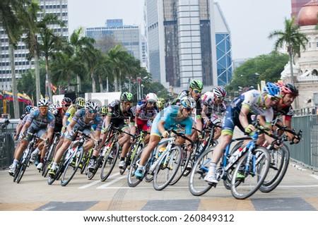 KUALA LUMPUR - MARCH 15 : An unidentifed  group of cyclists taking corner during stage 8 Le Tour de Langkawi 2015 from Kuala Kubu baru to Kuala Lumpur, Malaysia on March 15, 2015. - stock photo