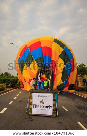 KUALA LUMPUR - MARCH 30: Balloon of South Korea landed at the middle of the road during 5th Putrajaya International Hot Air Balloon on March 30, 2013 - stock photo