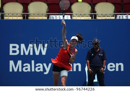 KUALA LUMPUR -MARCH 4: Jelena Jankovic serves during a semi-finals match against Petra Martic at the BMW Malaysian Open on March 3,2012 in Kuala Lumpur, Malaysia. Petra Martic won [6-7(5-7),7-5,7-6 (7-5)] - stock photo