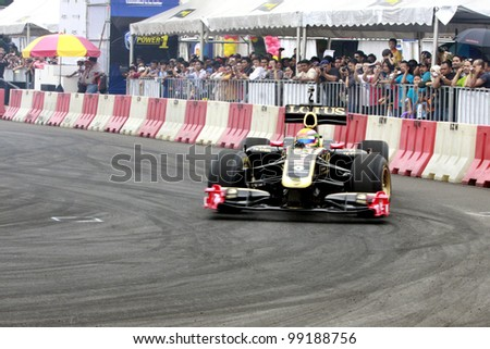 KUALA LUMPUR-MARCH 18: Lotus F1 car Track Demostration by Ho Pin Tung at the Proton Power of 1 Exhibition on March 18, 2012 in Kuala Lumpur, Malaysia. Ho Pin Tung is a Chinese-Dutch auto-racing. - stock photo