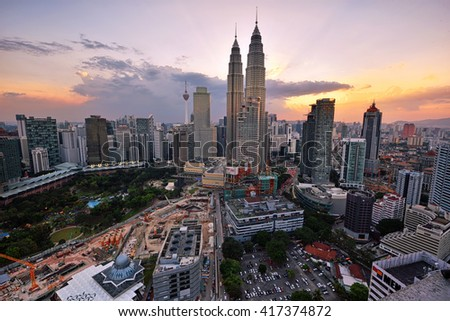 KUALA LUMPUR - MARCH 02, 2016 - Majestic view of Petronas Twin Towers during blue hour sunset with dramatic sky. Petronas Twin Towers also known as KLCC is the tallest building in Malaysia. - stock photo
