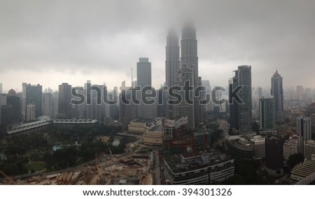 KUALA LUMPUR - MARCH 22: Panoramic view of Kuala Lumpur city skyline shrouded in thick haze and low hanging clouds on March 22, 2016 in Kuala Lumpur Malaysia