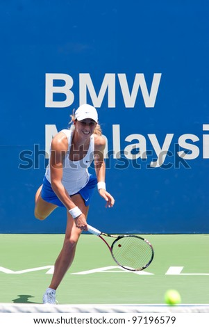 KUALA LUMPUR-MARCH 4: Petra Martic (CRO) serves ball during BMW Malaysia Open against Jelena Jankovic (SRB) on March 4, 2012 in Kuala Lumpur, Malaysia. Martic Won 6:7(5), 7:5, 7:6(5) - stock photo