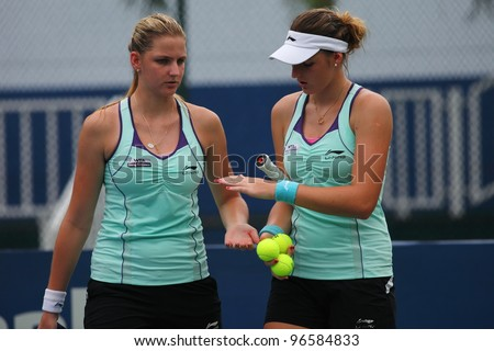 KUALA LUMPUR, March 2: Pliskova sisters  during a double quarterfinal match against Hsu Wen-Hsin/Lu Jing-Jing at the BMW Malaysian Open on March 2,2012 in Kuala Lumpur,Malaysia. Pliskova win (5:7,3:6) - stock photo
