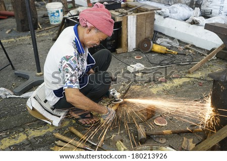 KUALA LUMPUR-MARCH 02: Unidentified blacksmith does a demonstration at the Malaysia National Craft Day 2014 on March 02, 2014 in Kuala Lumpur, Malaysia. - stock photo