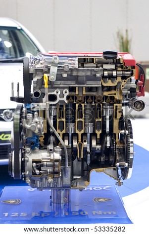 KUALA LUMPUR - MAY 18 : A cross section of  Proton Exora engine on display during the 6th World Islamic Economic Forum (WIEF) May 18, 2010 in Kuala Lumpur, Malaysia. - stock photo