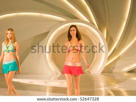KUALA LUMPUR - MAY 8:  models pose an outfit creation by Schwarzenbach during Licence To Styles fashion show on May 8,2010 in Kuala Lumpur Malaysia - stock photo
