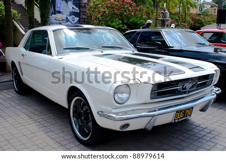 KUALA LUMPUR - NOV 13: A Ford Mustang 289 on display at the Asia Klasika Malaysia International Vintage & Classic Car Concours during COTY2U Autoshow on November 13, 2011 in Kuala Lumpur, Malaysia. - stock photo