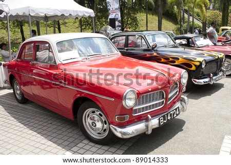 KUALA LUMPUR - NOV 13: A Red 1965 Volvo Amazon 122S on display at the Asia Klasika Malaysia International Vintage & Classic Car Concours COTY2U Autoshow on November 13, 2011 in Kuala Lumpur, Malaysia.