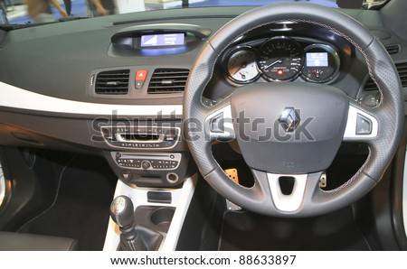 KUALA LUMPUR - NOV 12: Dashboard of Renault Megane RS at the Car Of The Year Auto Show on November 12 2011 in Kuala Lumpur, Malaysia. Renault Megane the three-door hatch with 2 litre 4pot turbocharged - stock photo