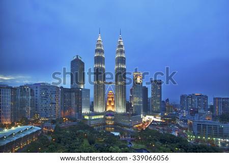 KUALA LUMPUR - NOV 15 : The Petronas Twin Towers on November 15 , 2015, in Kuala Lumpur, Malaysia are the world's tallest twin tower. The skyscraper height is 451.9m - stock photo